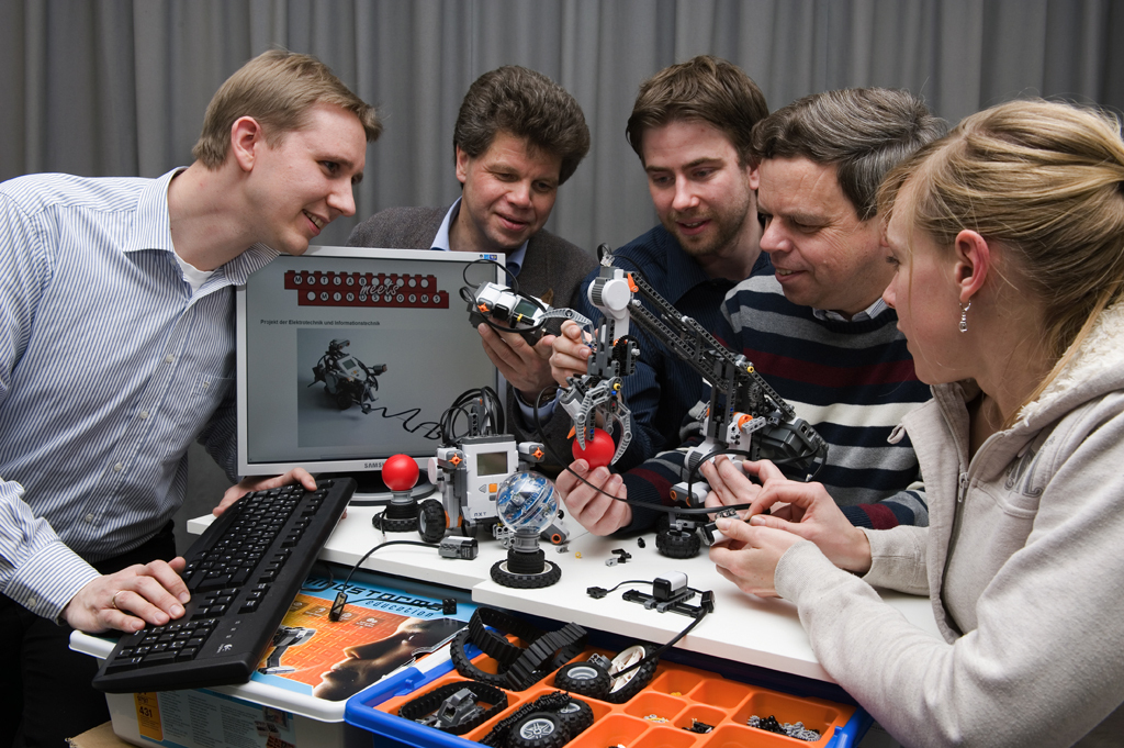 Researchers with robots
