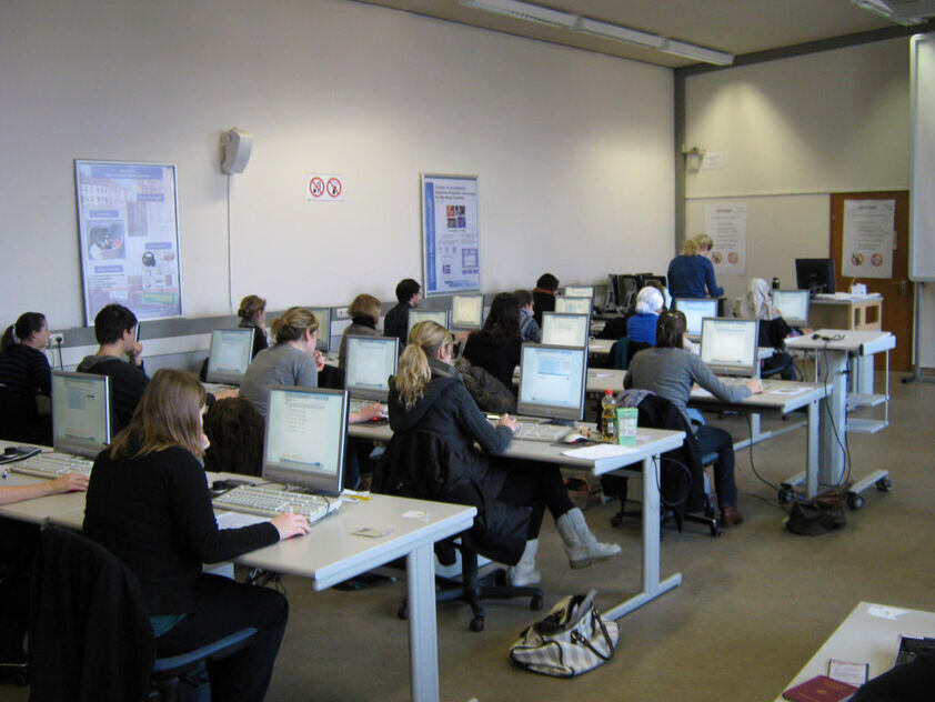 Students work on PCs in a lecture hall